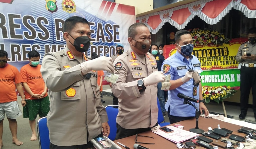 Polres Metro Depok menggelar perkara kasus penipuan dan penggelapan kendaraan. (Foto: PMJ News).